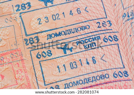 Passport page with the immigration control stamps of the Domodedovo airport in Moscow, Russia. - stock photo