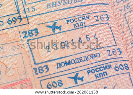 Passport page with the immigration control stamps of the Domodedovo and Vnukovo international airports in Moscow, Russia. - stock photo