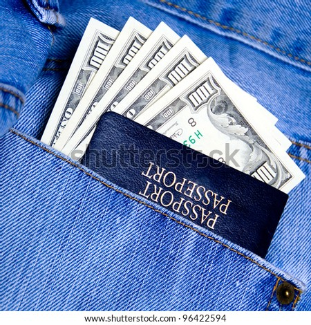 Passport with American dollars in the pocket of jeans - stock photo