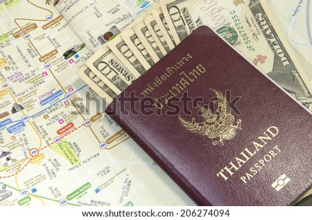 passport with bank notes and map - stock photo