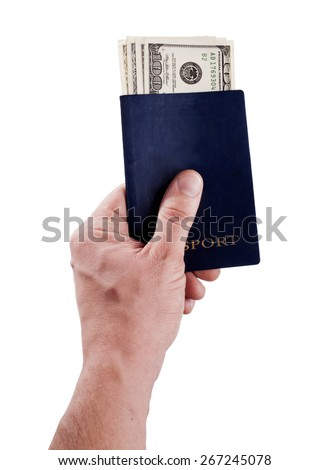 Passport with dollar bills - bribery.