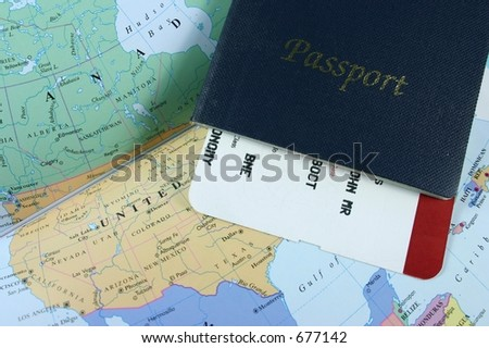 Passport, with flight boarding pass on map - stock photo