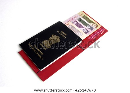 Passport with Indian currency notes  - stock photo
