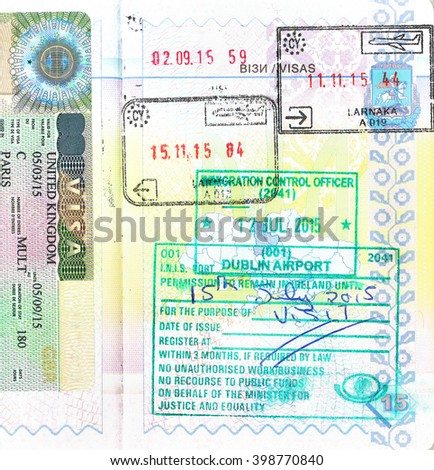 Passport with UK visa and stamps of Cyprus and Ireland - stock photo