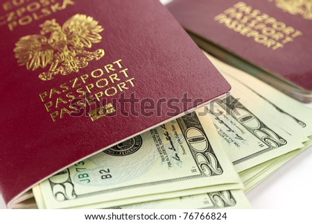 Passports and money over white background