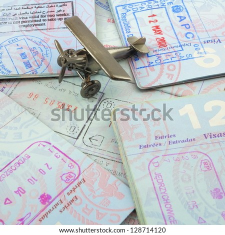 Passports and toy airplane - stock photo