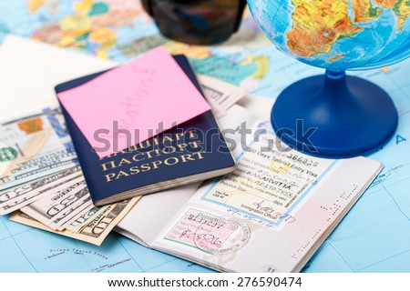 Passports, money, tickets, globe and map of the world as a vacation concept. Summer journey preparation. Planning holidays, cheking documents, choosing destination point, having fun. - stock photo