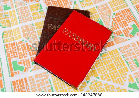 Passports on map background - stock photo