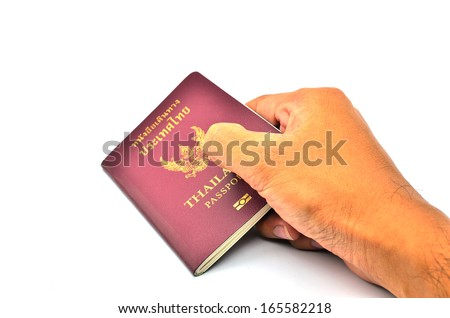 passports Thailand  in man hand isolated on white background