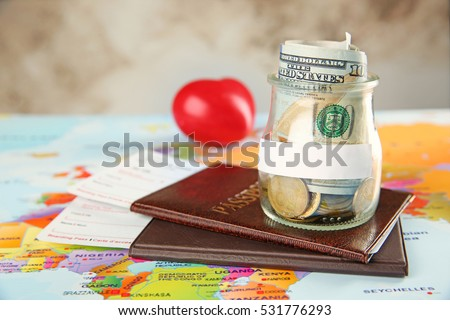 Passports with tickets and money for vacations on the world map background