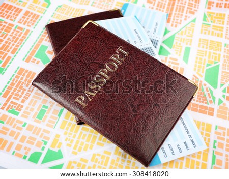 Passports with tickets on map background - stock photo