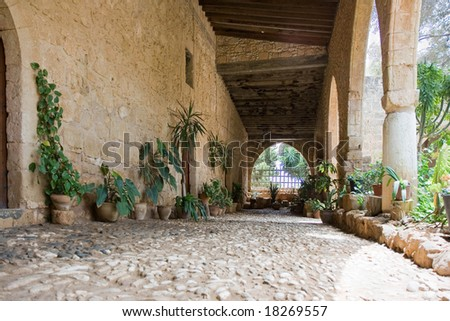 Passway between wall and pillars. Ancient architecture in Cyprus