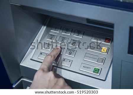 Password code protection Hand on button number Banking automatic teller machine