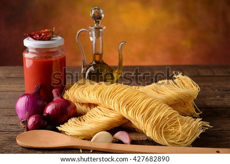Pasta all 'type of Tajarin egg with ingredients tomato chili and onion - stock photo
