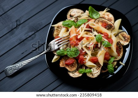 Pasta alla Norma made with penne, eggplant, tomato and cheese - stock photo