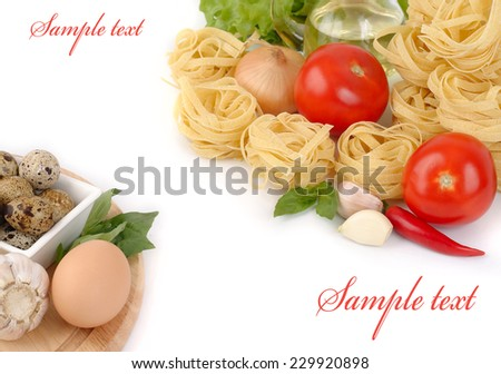 Pasta and fresh vegetables on a white background.