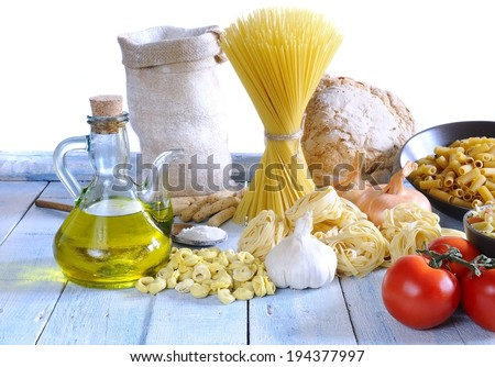 Pasta and ingredients on table of kitchen.