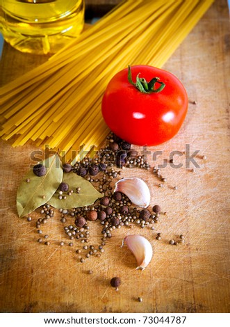 Pasta and red tomato with spices and garlic - stock photo