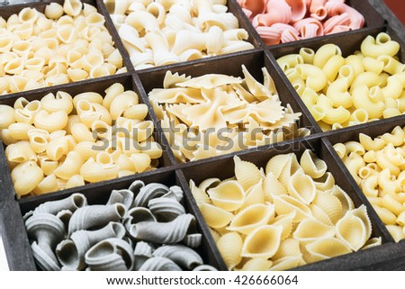 pasta assortment of different colors background  - stock photo