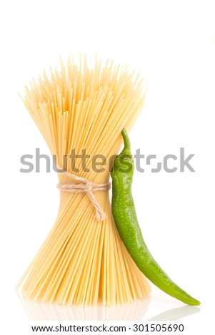 Pasta bunch with green hot chilly pepper - stock photo