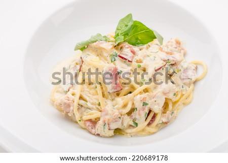 Pasta carbonara with bacon isolated on white background - stock photo