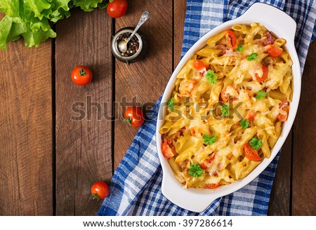 Pasta casserole, tomato, bacon and cheese. Top view - stock photo