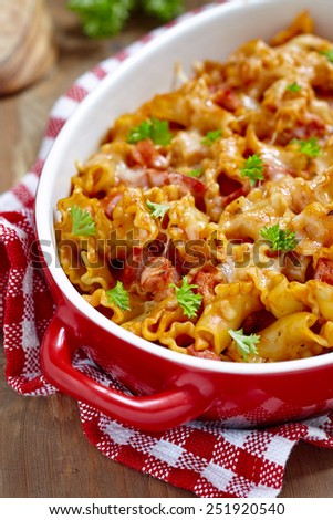 pasta casserole with cheese and ham with tomato and cream sauce
