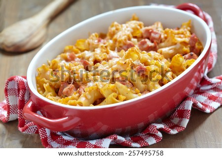 pasta casserole with cheese and ham with tomato and cream sauce - stock photo