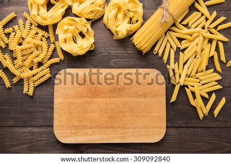 Pasta collection on rustic wooden background.
