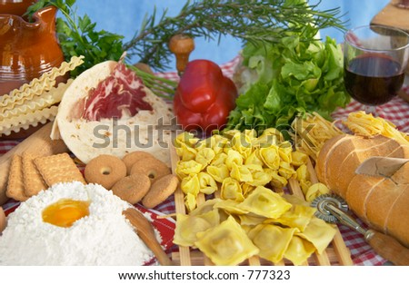 Pasta, egg, flour, biscuits, vegetables, wine typical ingredients of Italian and Mediterranean food - stock photo