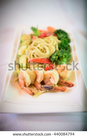 Pasta fettuccine with salmon and caviar on a white dish - stock photo
