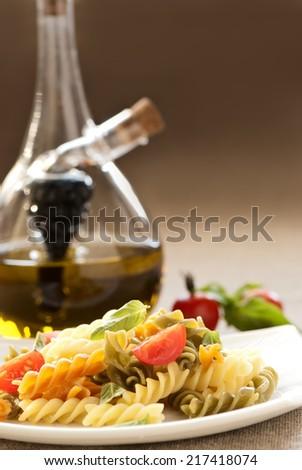 Pasta fusilli with tomato and basil - stock photo