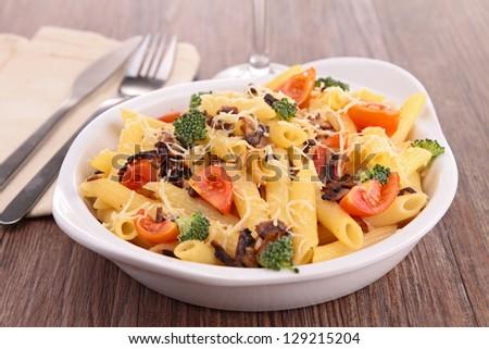 pasta gratin with broccoli and tomato - stock photo