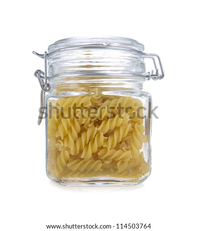 Pasta in glass jar on a white background