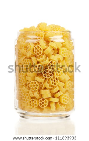 Pasta in glass pot isolated on white background