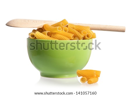 Pasta in green plate with wooden spoon, isolated on white background
