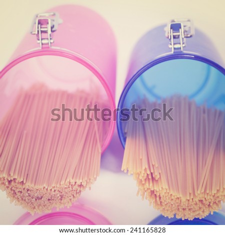 Pasta in Pink and Blue Glass Jar, Instagram Effect - stock photo