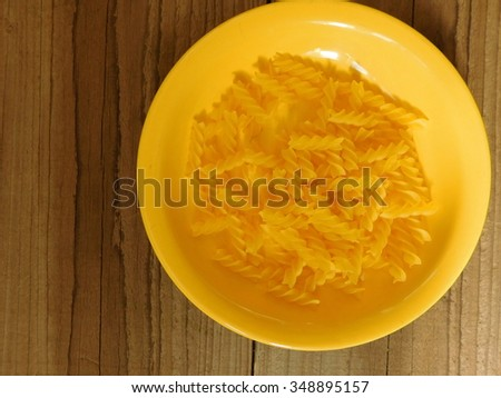pasta in the dish made of wood
