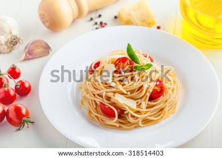 Pasta in tomato sauce with parmesan cheese and basil