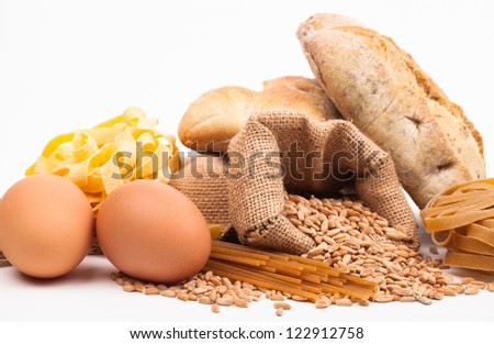 pasta ingredients assortment and bread isolated on white background