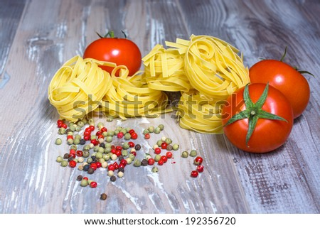 pasta ingredients  tomato and peper on wood background