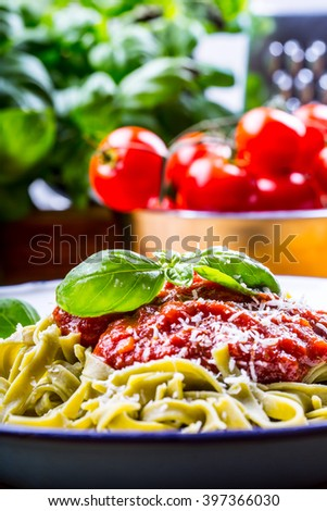 Pasta. Italian and Mediterranean cuisine. Pasta Fettuccine with tomato sauce basil leaves garlic and parmesan cheese. An old home kitchen with old kitchen utensils. - stock photo