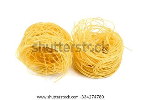 pasta nest isolated on white - stock photo
