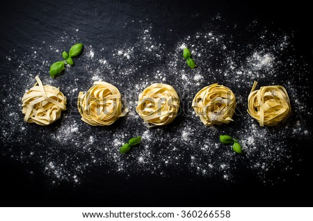 Pasta on dark background - stock photo