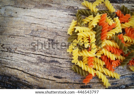 Pasta on wooden background