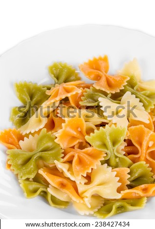Pasta penne rigate on a plate. Whole background. - stock photo