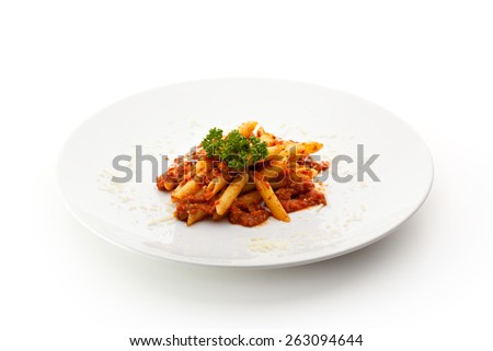 Pasta Penne with Bolognese Sauce. Garnished with Parsley - stock photo