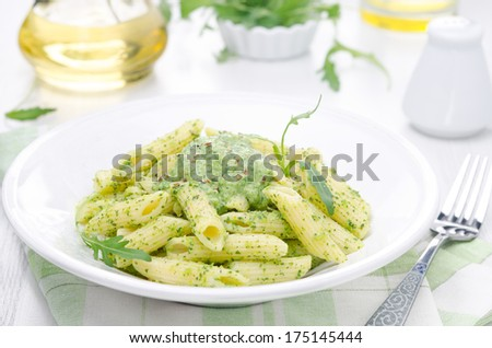 pasta penne with sauce of arugula and peas on a plate