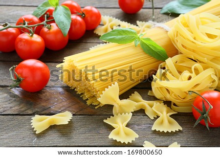 pasta products with tomato and basil, food closeup - stock photo