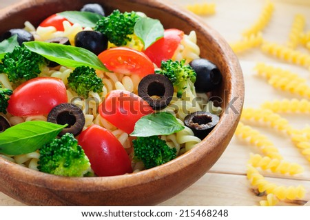 pasta salad in wooden bowl - stock photo